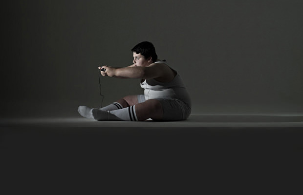 obese kid playing unhealthy video games